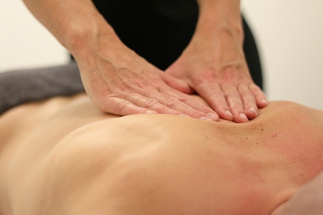 Deep tissue back massage provided by spa therapist